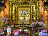 Here Confucius and Gong Yu honored side by side with offerings of incense, fruit and cash.