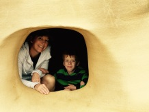 Mommy & Bodhi peek out from a wind cave.