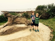"""Kids pose with a famous rock formation called """"The Leopard""""."""