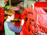 """Griffin paints his wish on our lantern: """"I wish I could get Halo 5 sooner."""""""